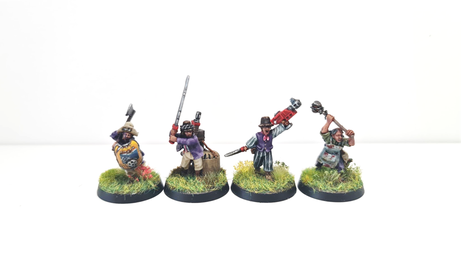Four ratling cultists on meadow bases.
