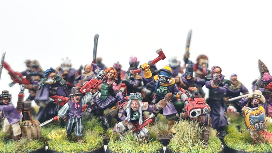 All of the cultists arranged together in a group photo.