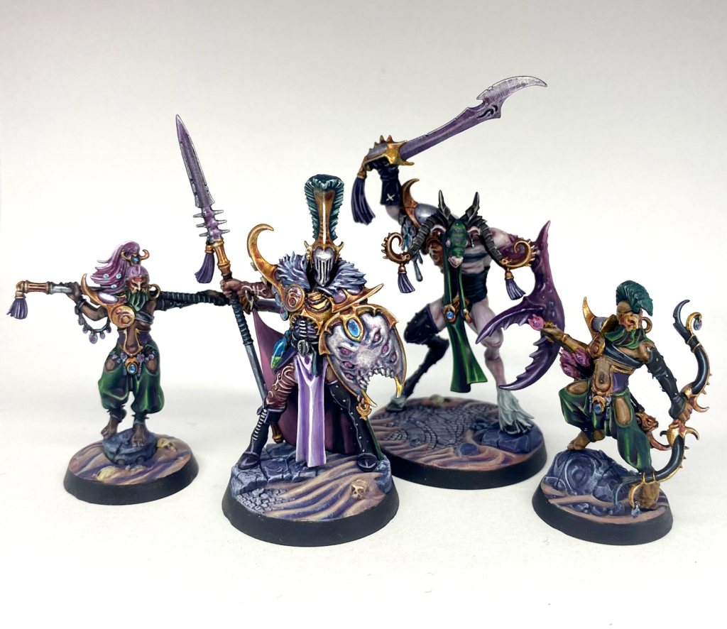 A photo of the four members of the Dread Pageant, the Slaanesh Warhammer Underworlds warband.