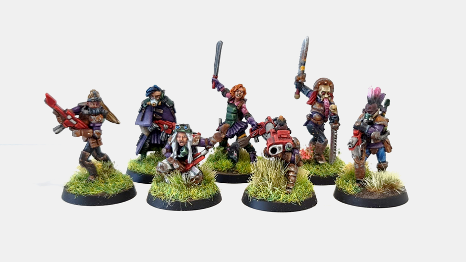 Seven female cultist miniatures on meadow bases.