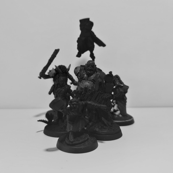 Slightly darkened, blurry photo showing the silhouettes of future models to be completed.