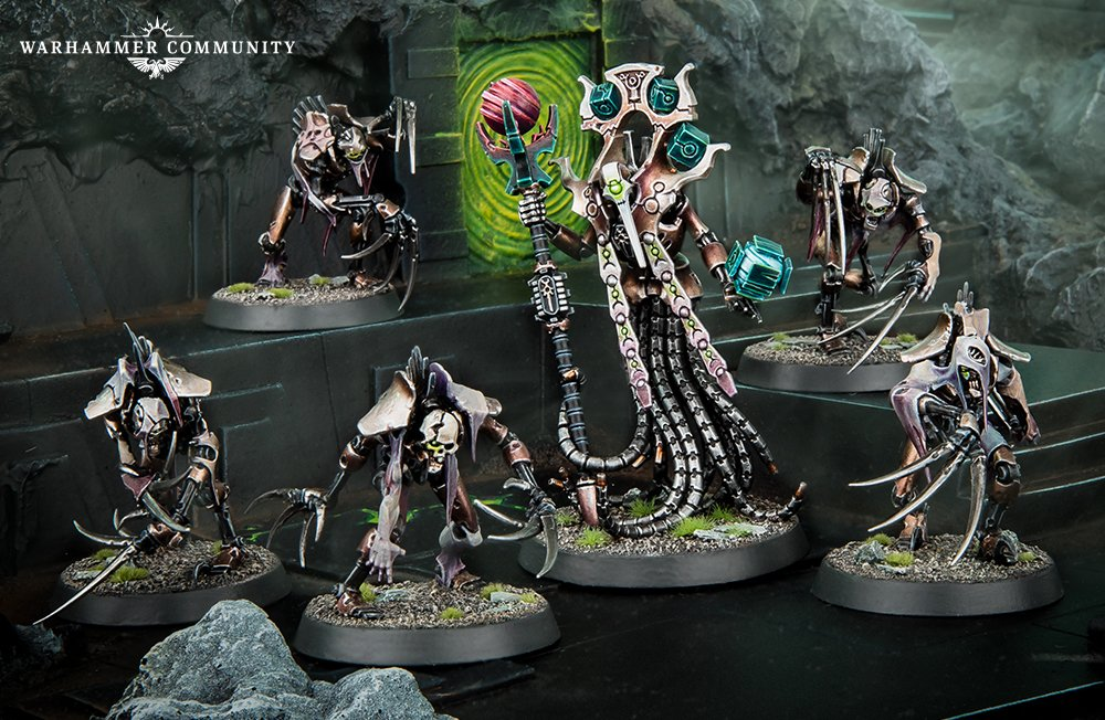 Promotional image of a chronomancer - a robot skeleton with long tentacles, wielding a staff and several ornate cubes, surrounded by flayed ones, robot skeletons with long claws draped in human flesh