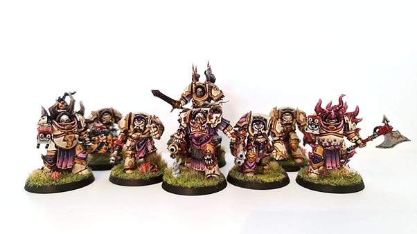 A photo showing the converted tainted cohort terminator models mixed into a standard unit of five chaos terminators.