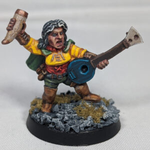 A female dwarf bard model. The model is holding a drinking horn in one hand and a stringed musical instrument in the other.