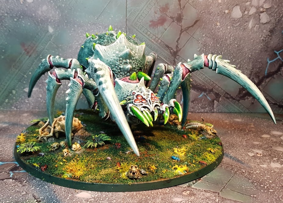 large 28mm spider monster with a grey green carapace and green fangs