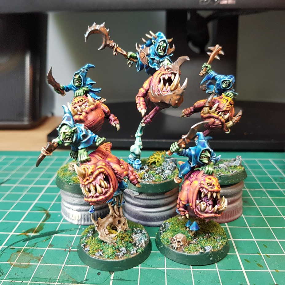 five 28mm blue robed goblins riding pink squigs and wielding a variety of hand weapons