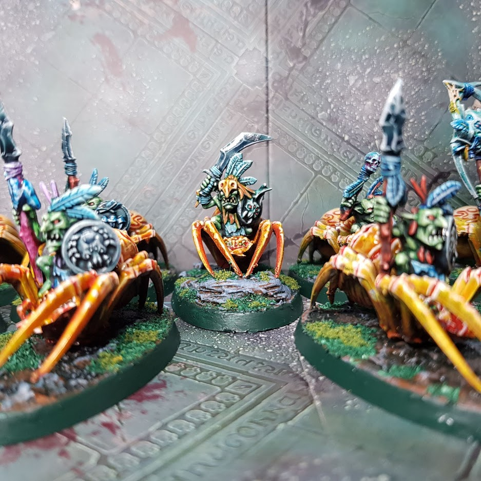 group of 28mm goblins with feathers and swords riding spiders
