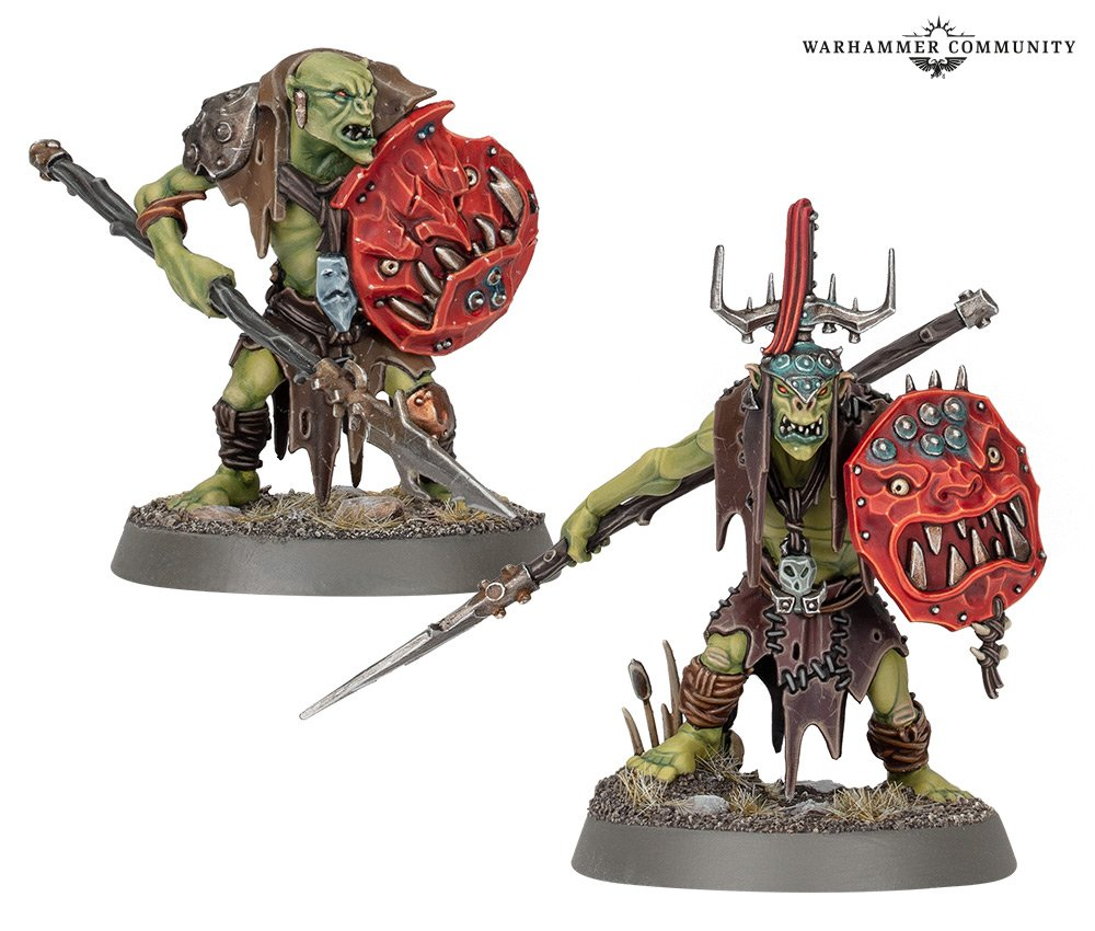 A pair of model orks, armed with vicious spears and shields decorated with leering red faces.