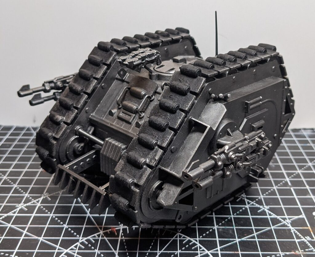 Side view of a vintage Rogue Trader-era Games Workshop Land Raider, Based and drybrushed in a range of silver paints