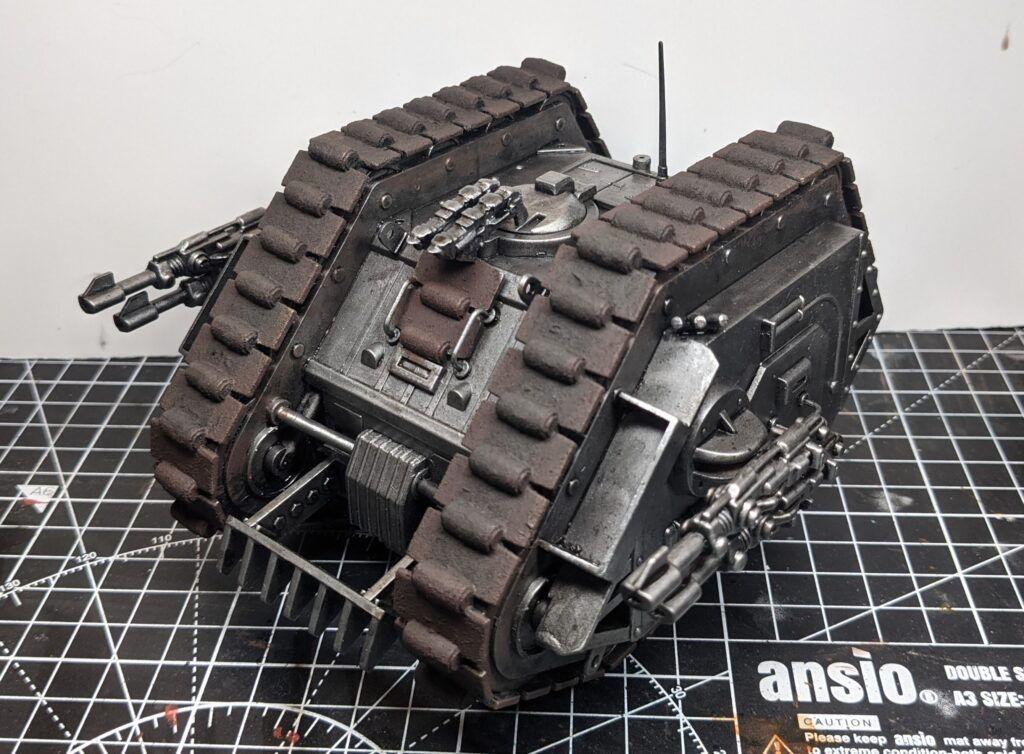 Front view of the vintage Rogue Trader-era Games Workshop Land Raider, with the track sections painted a rusty dark brown