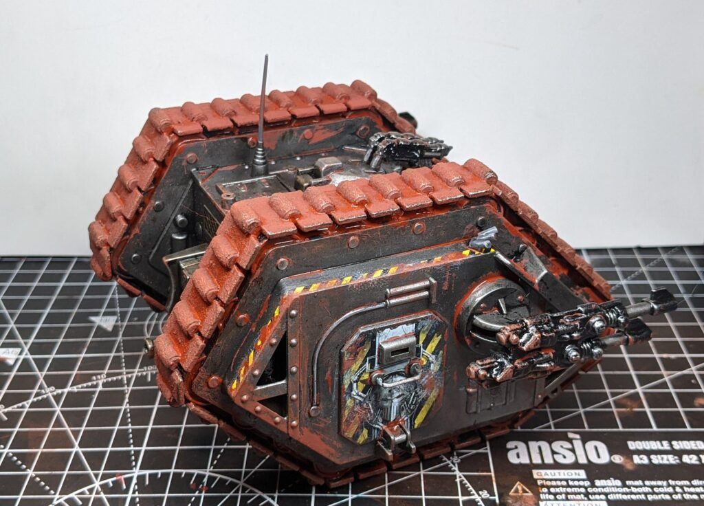 Side view of the land raider, with messily-applied orange red weathering