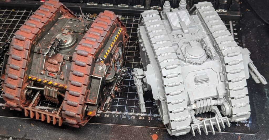 High view of the completed land raider, next to a modern Land Raider Proteus from Forge World.