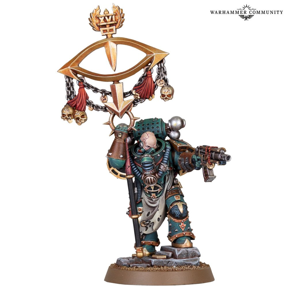 A model of a space marine in sea-green armour, carrying a banner with an icon of an eye.