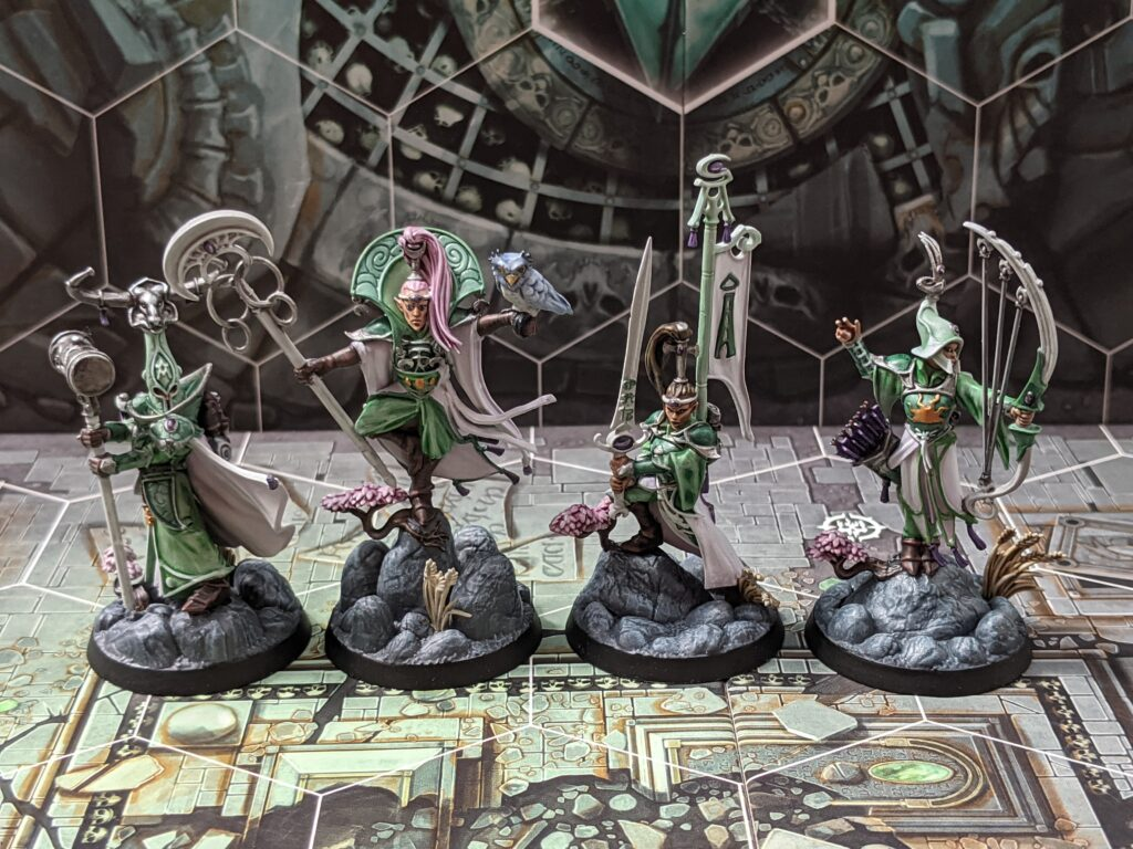 Four elf models, painted in a green and white colour scheme.