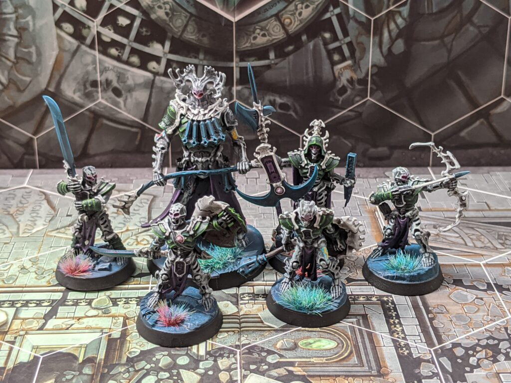 Six armoured skeleton models, painted with grey bone and green armour.