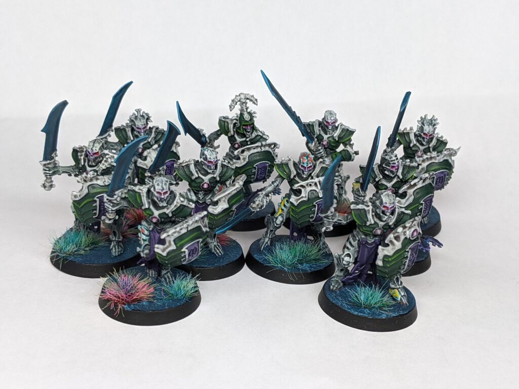A unit of ten skeletal construct warriors, armed with dark blades and segmented green shields