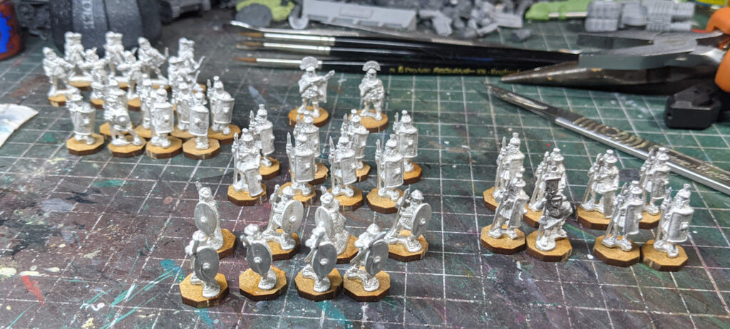 An array of small-scale metal Roman soldiers, on MDF hexagonal bases